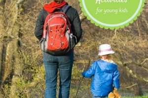 Image of parent and child walking in the woods for a post on Spring Break Activities