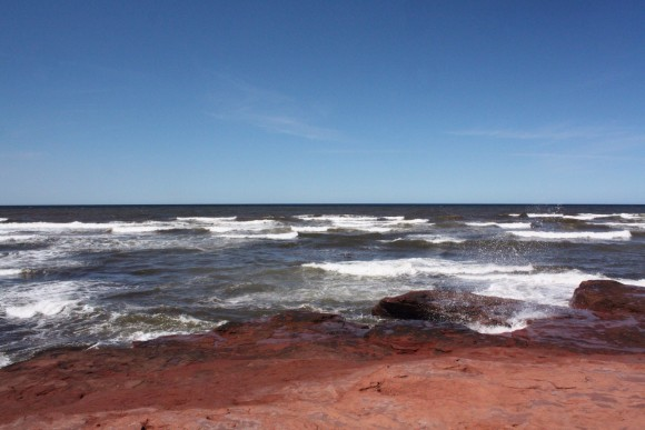 Stunning views of red rock at the water's edge can be found in PEI National Park, Cavendish. Photo copyright Sheri Landry