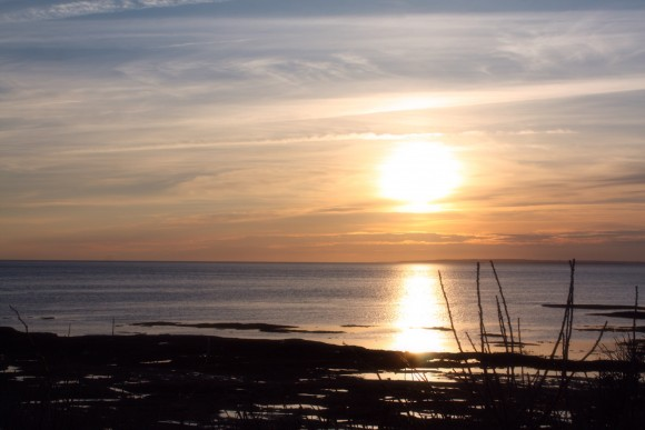 Sunset in PEI off the shore at Point Prim in Prince Edward Island. Photo copyright Sheri Landry