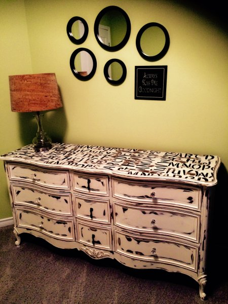 Turn an old dresser into a vintage chic change table. Nursery view.