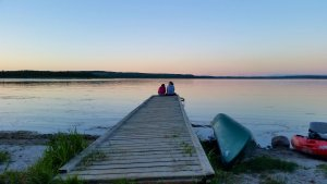 Sitting on the dock and watching the sun go down. Photo credit Stacey Brotzel.