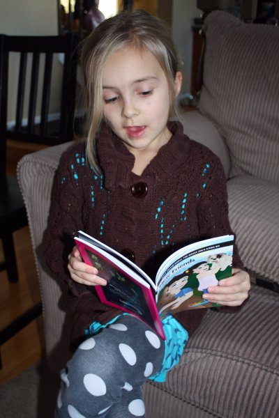 At seven, our daughter has improved her reading through this app. She now tries to read chapter books and has become better at sounding out words she doesn't understand. We received some of the books from the game from Ooka Island and she immediately claimed the two chapter books in the set. Photo copyright, Sheri Landry.