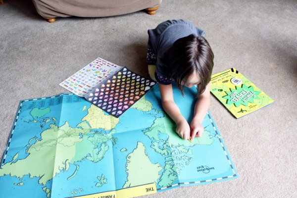 Our five year old is adding the 'where I live' sticker to the map. This is a great way to teach kids about the world and their location in it.