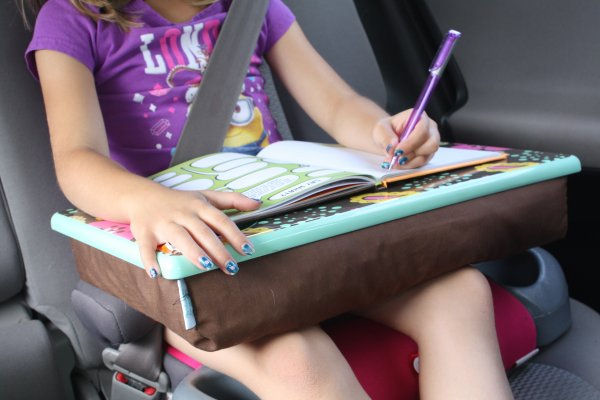 A lap desk is a great item to have in the car. Kids can write, eat, colour, do crafts and more.