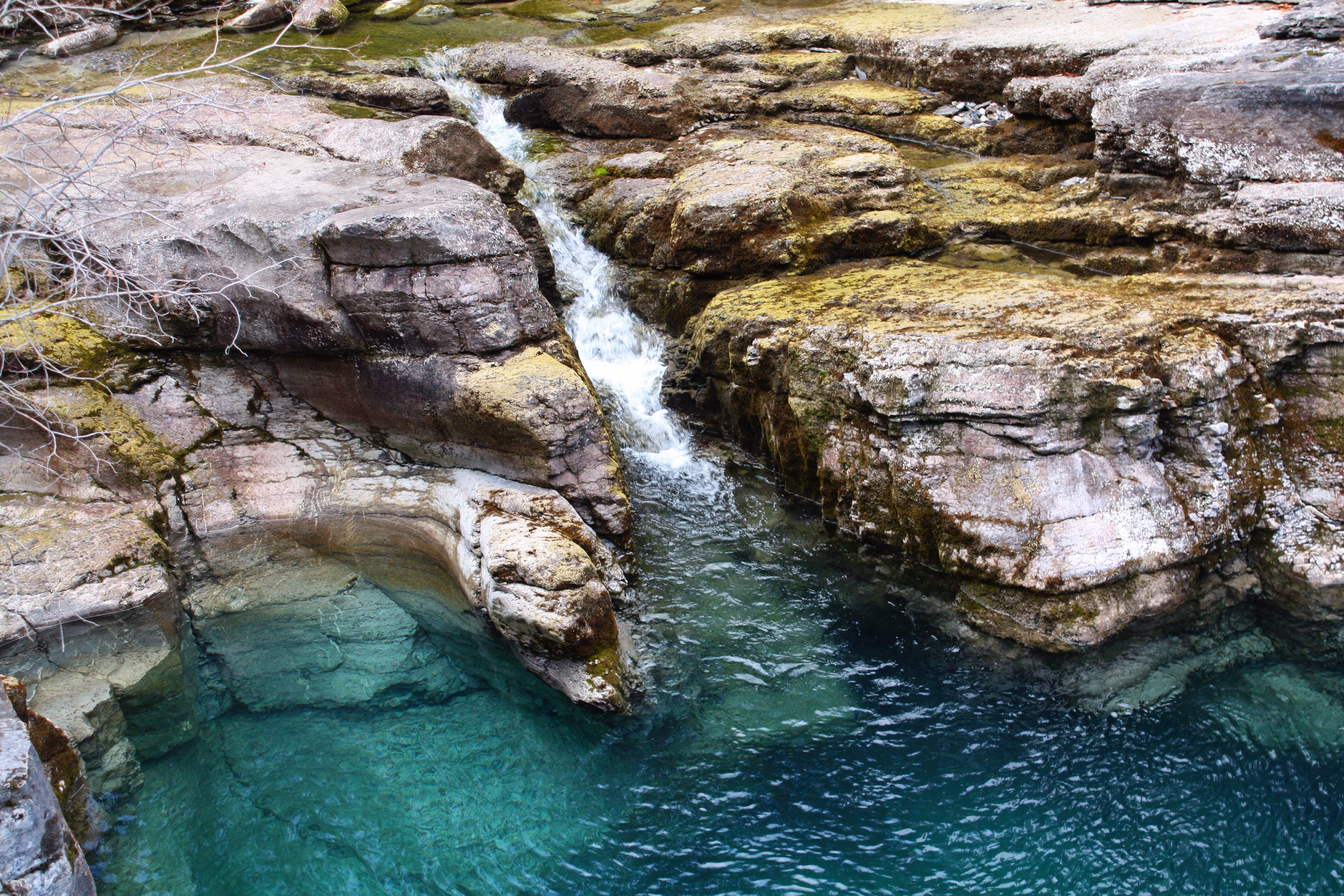 Gorgeous blue streams and falls line the hike at Maligne Canyon. Normally these areas slow to a trickle at this time of year but due to additional snow in the mountains and a warmer fall, the water stayed for a little longer. Photo copyright Sheri Landry.