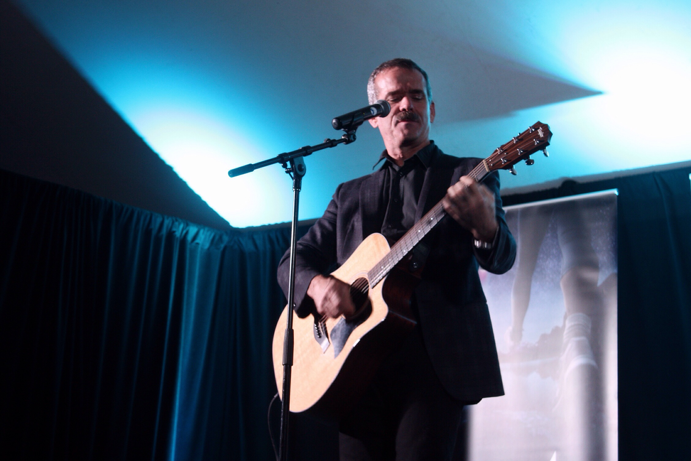 Col. Chris Hadfield ended his inspirational session with some audience questions. And there's always time for music. Photo copyright Sheri Landry